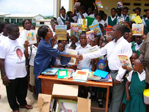 Children receiving much needed books from KMF
