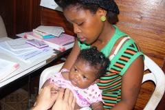 Child receive meds donated by KMF at Buduburam Refugee clinic
