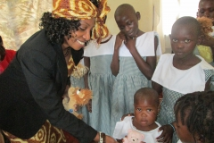 Kay giving out toys to children in Uganda orphanage
