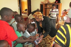 Kay handing out toys to the boys at Uganda orphanage