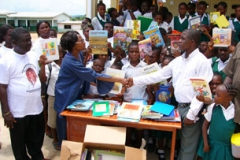 Kay donate books to Liberian refugee children at St Gregory Elementary